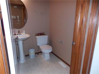 Photo 11: 120 SUNSET Close: Cochrane House for sale : MLS®# C4038629