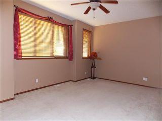 Photo 14: 120 SUNSET Close: Cochrane House for sale : MLS®# C4038629