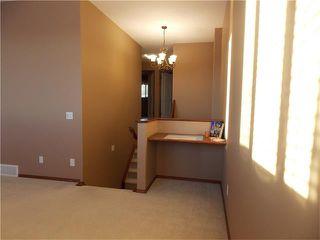 Photo 16: 120 SUNSET Close: Cochrane House for sale : MLS®# C4038629