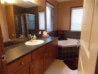 Photo 22: 120 SUNSET Close: Cochrane House for sale : MLS®# C4038629