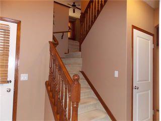 Photo 12: 120 SUNSET Close: Cochrane House for sale : MLS®# C4038629