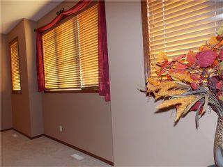 Photo 15: 120 SUNSET Close: Cochrane House for sale : MLS®# C4038629