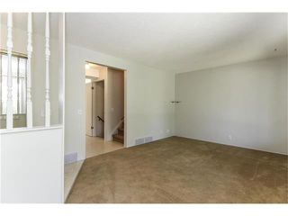 Photo 8: 115 PINESON Place NE in Calgary: Pineridge House for sale : MLS®# C4065261