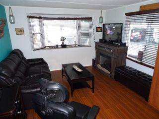 """Photo 4: 15 4200 DEWDNEY TRUNK Road in Coquitlam: Ranch Park Manufactured Home for sale in """"HIDEWAY PARK"""" : MLS®# R2124110"""