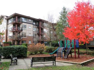 "Photo 14: 201 200 KLAHANIE Drive in Port Moody: Port Moody Centre Condo for sale in ""SALAL"" : MLS®# R2222800"