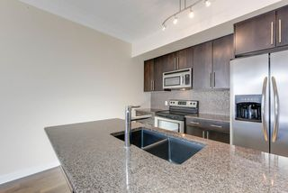 Photo 3: 304 11203 103A Avenue NW in Edmonton: Zone 12 Condo for sale : MLS®# E4140077