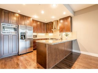 Photo 4: 402 1415 PARKWAY BOULEVARD in Coquitlam: Westwood Plateau Condo for sale : MLS®# R2416229