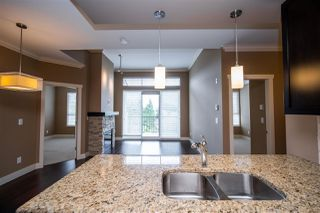 "Photo 8: 404 3192 GLADWIN Road in Abbotsford: Central Abbotsford Condo for sale in ""BROOKLYN"" : MLS®# R2463286"
