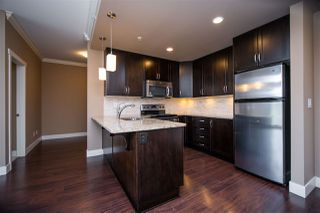 "Photo 4: 404 3192 GLADWIN Road in Abbotsford: Central Abbotsford Condo for sale in ""BROOKLYN"" : MLS®# R2463286"
