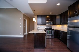 "Photo 9: 404 3192 GLADWIN Road in Abbotsford: Central Abbotsford Condo for sale in ""BROOKLYN"" : MLS®# R2463286"