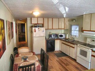 "Photo 2: 49 4200 DEWDNEY TRUNK Road in Coquitlam: Ranch Park Manufactured Home for sale in ""HIDEAWAY PARK"" : MLS®# V902825"