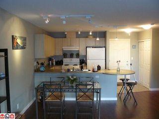 """Photo 2: 202 12083 92A Avenue in Surrey: Queen Mary Park Surrey Condo for sale in """"TAMARON"""" : MLS®# F1129601"""