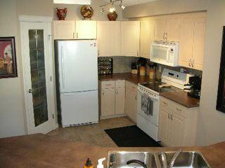 Photo 4: 4206 MCMULLEN PLACE SW: House for sale (Macewan)