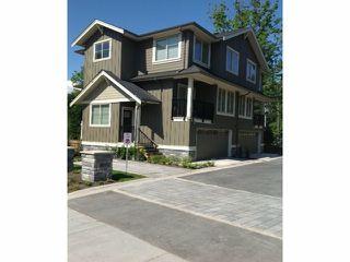 "Photo 1: 7 3266 147 Street in Surrey: Elgin Chantrell Townhouse for sale in ""Elgin Oaks"" (South Surrey White Rock)  : MLS®# F1324983"