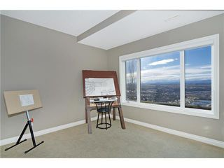 Photo 14: 190 GLENEAGLES ESTATES Lane: Cochrane House for sale : MLS®# C3644568