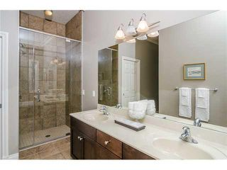 Photo 12: 190 GLENEAGLES ESTATES Lane: Cochrane House for sale : MLS®# C3644568