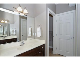 Photo 15: 190 GLENEAGLES ESTATES Lane: Cochrane House for sale : MLS®# C3644568