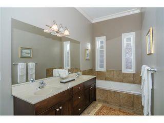 Photo 11: 190 GLENEAGLES ESTATES Lane: Cochrane House for sale : MLS®# C3644568