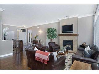 Photo 7: 190 GLENEAGLES ESTATES Lane: Cochrane House for sale : MLS®# C3644568