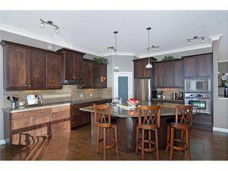 Photo 2: 190 GLENEAGLES ESTATES Lane: Cochrane House for sale : MLS®# C3644568