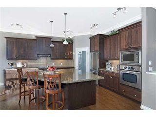 Photo 3: 190 GLENEAGLES ESTATES Lane: Cochrane House for sale : MLS®# C3644568