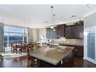 Photo 4: 190 GLENEAGLES ESTATES Lane: Cochrane House for sale : MLS®# C3644568
