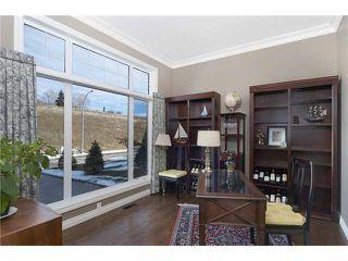 Photo 13: 190 GLENEAGLES ESTATES Lane: Cochrane House for sale : MLS®# C3644568