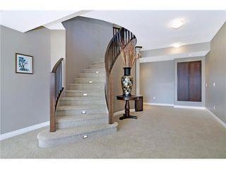 Photo 17: 190 GLENEAGLES ESTATES Lane: Cochrane House for sale : MLS®# C3644568