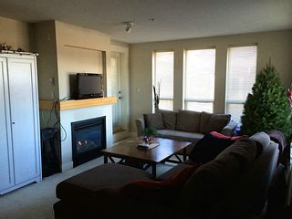 """Photo 4: 211 1211 VILLAGE GREEN Way in Squamish: Downtown SQ Condo for sale in """"ROCKCLIFFE"""" : MLS®# V1097471"""