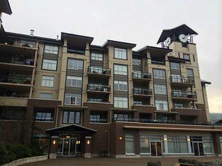 """Photo 1: 211 1211 VILLAGE GREEN Way in Squamish: Downtown SQ Condo for sale in """"ROCKCLIFFE"""" : MLS®# V1097471"""