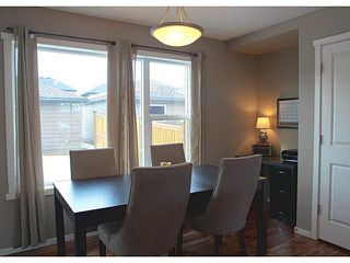 Photo 6: 418 WALDEN Drive SE in Calgary: Walden House for sale : MLS®# C3649474