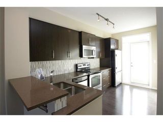 Photo 4: 334 ASCOT Circle SW in Calgary: Aspen Woods House for sale : MLS®# C4047112