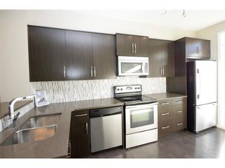 Photo 5: 334 ASCOT Circle SW in Calgary: Aspen Woods House for sale : MLS®# C4047112