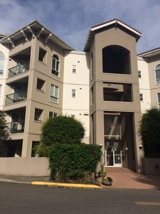 "Photo 1: 202 3174 GLADWIN Road in Abbotsford: Central Abbotsford Condo for sale in ""REGENCY PARK"" : MLS®# R2078392"