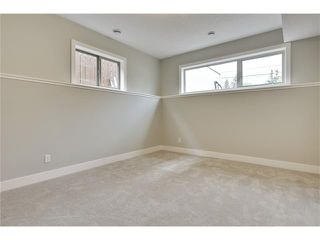 Photo 27: 5628 LODGE Crescent SW in Calgary: Lakeview House for sale : MLS®# C4070560