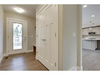 Photo 17: 5628 LODGE Crescent SW in Calgary: Lakeview House for sale : MLS®# C4070560