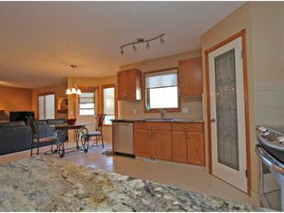 Photo 8: 275 WATERSTONE Crescent SE: Airdrie Residential Detached Single Family for sale : MLS®# C3622890