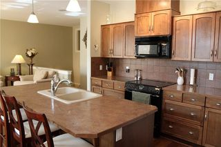 Photo 6: 348 CRYSTAL GREEN Rise: Okotoks House for sale : MLS®# C4113654