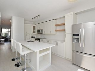 """Photo 7: 102 20449 66 Avenue in Langley: Willoughby Heights Townhouse for sale in """"Natures Landing"""" : MLS®# R2260728"""
