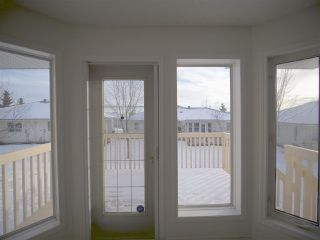 Photo 7: 58 14428 MILLER Boulevard NW in Edmonton: Zone 02 House Half Duplex for sale : MLS®# E4140792