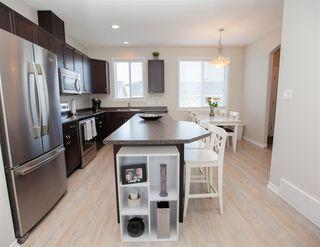 Photo 5: 9832 105 Avenue: Morinville Attached Home for sale : MLS®# E4150801