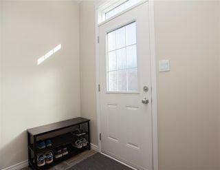 Photo 3: 9832 105 Avenue: Morinville Attached Home for sale : MLS®# E4150801