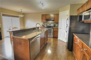 Photo 6: 11 COUGAR RIDGE Court SW in Calgary: Cougar Ridge Detached for sale : MLS®# C4243395