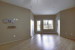Photo 4: 102 305 1 Avenue NW: Airdrie Apartment for sale : MLS®# A1041463