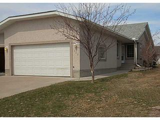 Photo 1: 130 RIVERSIDE Crescent NW: High River Residential Attached for sale : MLS®# C3612435