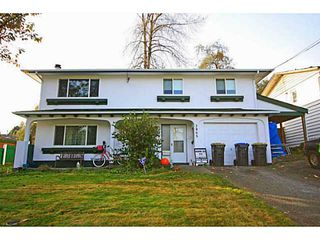 Photo 1: 3865 WELLINGTON Street in Port Coquitlam: Oxford Heights House for sale : MLS®# V1094588