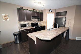 Photo 8: 446 TUSCANY RIDGE Heights NW in Calgary: Tuscany House for sale : MLS®# C4149116