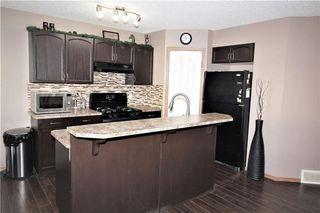 Photo 10: 446 TUSCANY RIDGE Heights NW in Calgary: Tuscany House for sale : MLS®# C4149116