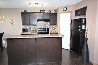 Photo 9: 446 TUSCANY RIDGE Heights NW in Calgary: Tuscany House for sale : MLS®# C4149116