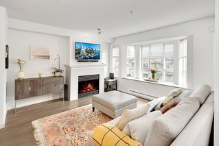 """Photo 2: 209 2545 W BROADWAY in Vancouver: Kitsilano Townhouse for sale in """"TRAFALGAR MEWS"""" (Vancouver West)  : MLS®# R2250630"""